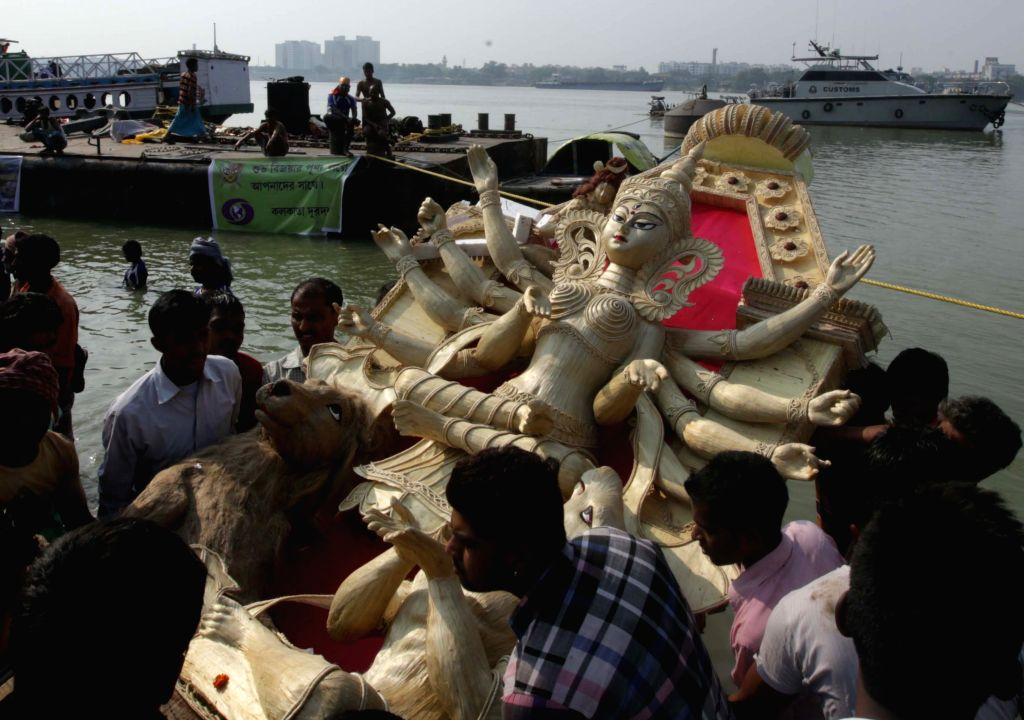Durga idols being immersed in the Hooghly river in Kolkata, on Oct 25, 2015.