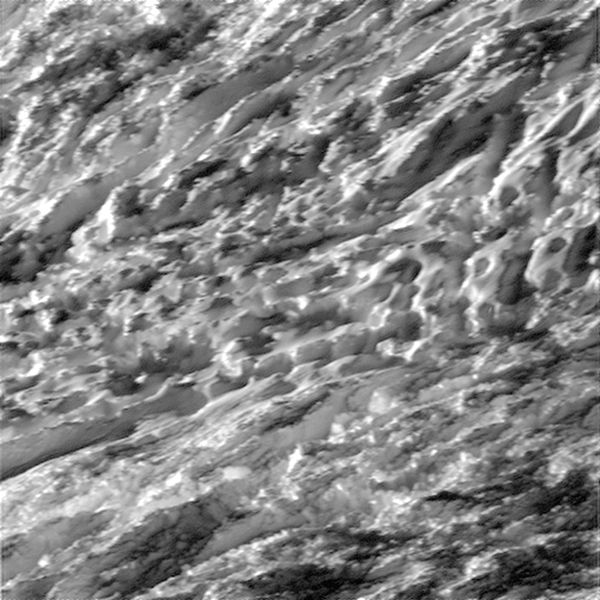 During its closest ever dive past the active south polar region of Saturn's moon Enceladus, NASA's Cassini spacecraft captured glimpses of the fast moving terrain below. Photo: NASA