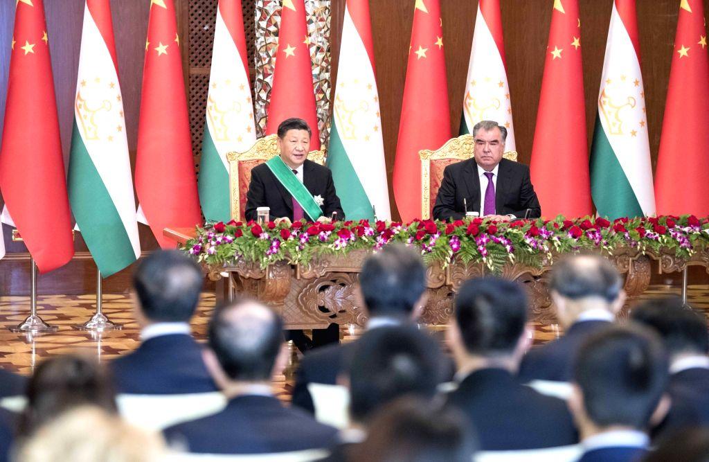 DUSHANBE, June 15, 2019 - Chinese President Xi Jinping and his Tajik counterpart Emomali Rahmon meet the press after their talks in Dushanbe, Tajikistan, June 15, 2019.