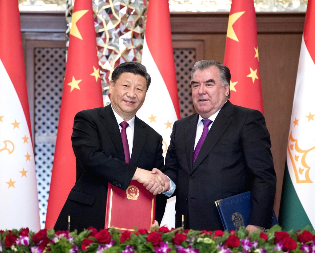 DUSHANBE, June 15, 2019 - Chinese President Xi Jinping (L) and his Tajik counterpart Emomali Rahmon sign a joint statement on further deepening China-Tajikistan comprehensive strategic partnership ...