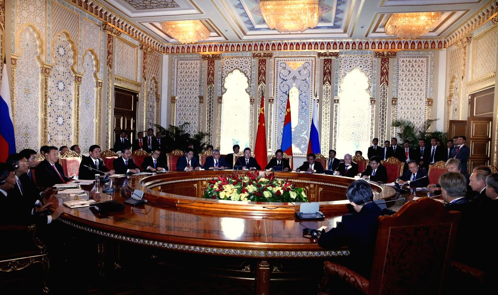Chinese President Xi Jinping (L front) meets with his Russian counterpart, Vladimir Putin (R front), in Dushanbe, capital of Tajikistan, Sept. 11, 2014. ...