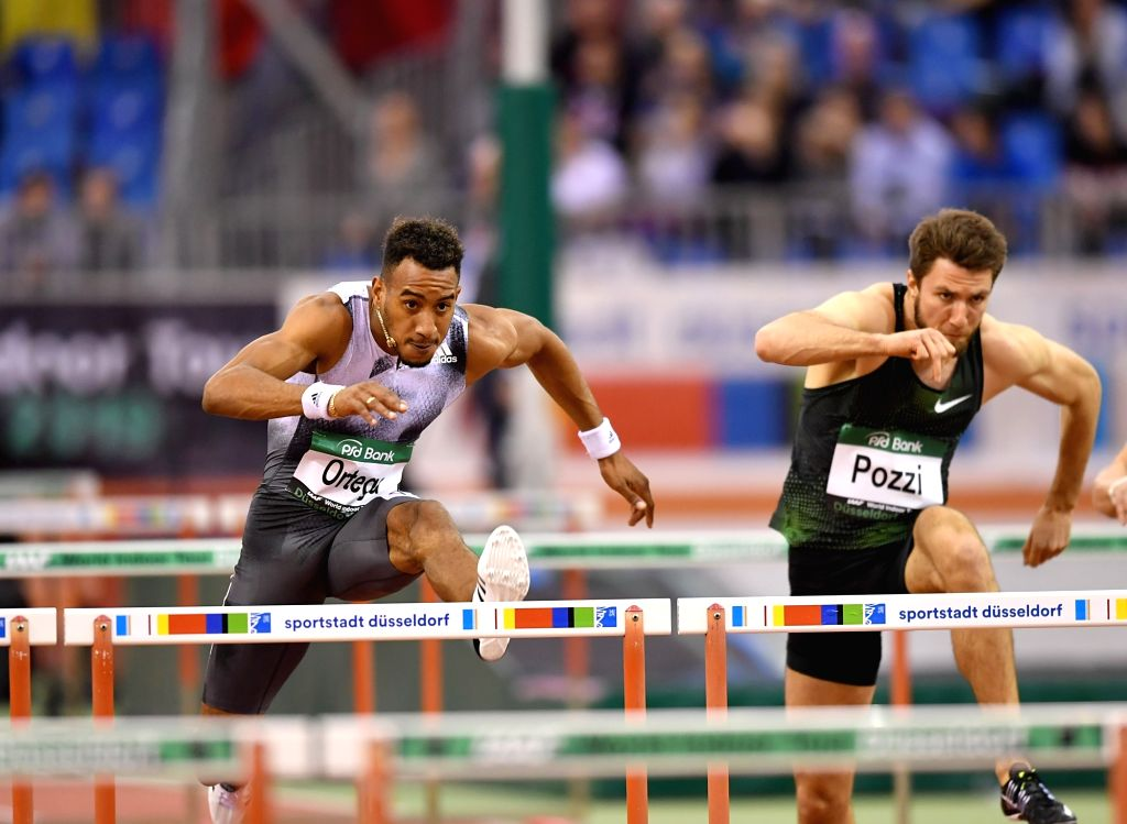 DUSSELDORF, Feb. 21, 2019 - Orlando Ortega (L) of Spain competes during the Men's 60m Hurdle final of the 2019 IAAF World Indoor Tour in Dusseldorf, Germany, on Feb. 20, 2019.