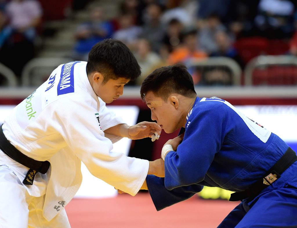 DUSSELDORF, Feb. 23, 2019 - Maruyama Joshiro (L) of Japan competes with Kim LimHwan of South Korea during men's -66kg final at the International Judo Federation (IJF) Dusseldorf Grand Slam 2019 in ...