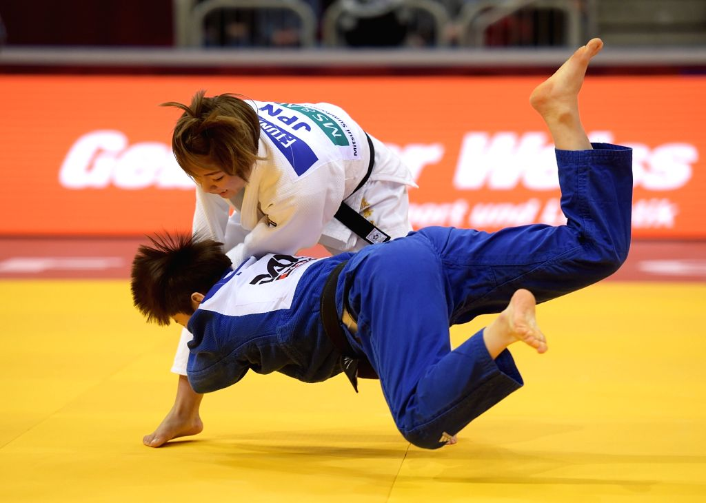 DUSSELDORF, Feb. 23, 2019 - Tonaki Funa (up) of Japan competes with Kang Yujeong of South Korea during women's -48kg final at the International Judo Federation (IJF) Dusseldorf Grand Slam 2019 in ...
