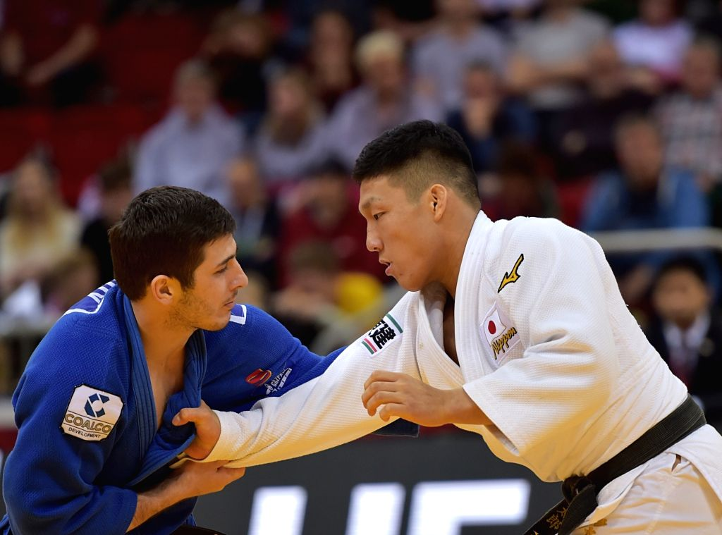 DUSSELDORF, Feb. 24, 2019 - Fujiwara Sotaro (R) of Japan competes with Aslan Lappinagov of Russia during men's -81kg final at the International Judo Federation (IJF) Dusseldorf Grand Slam 2019 in ...