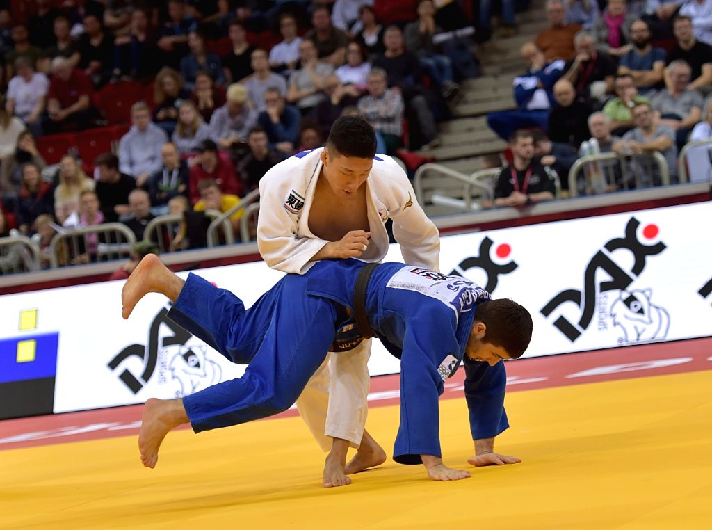 DUSSELDORF, Feb. 24, 2019 - Fujiwara Sotaro (up) of Japan competes with Aslan Lappinagov of Russia during men's -81kg final at the International Judo Federation (IJF) Dusseldorf Grand Slam 2019 in ...