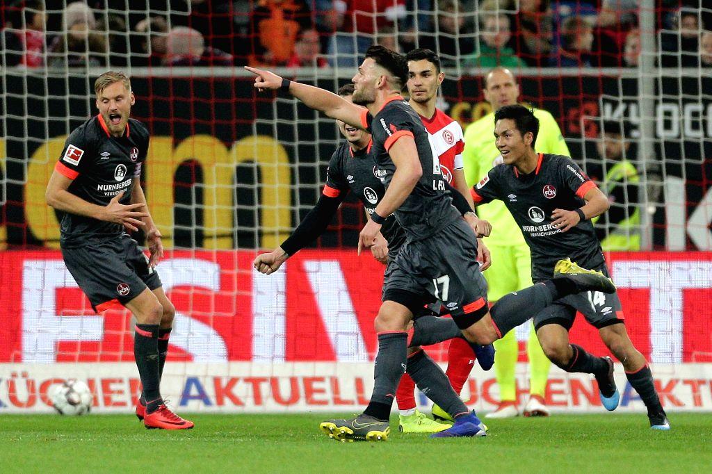 DUSSELDORF, Feb. 24, 2019 - Players of Dusseldorf celebrate after scoring during the Bundesliga match between Fortuna Dusseldorf and FC Nuernberg in Dusseldorf, Germany, Feb. 23, 2019. Dusseldorf won ...