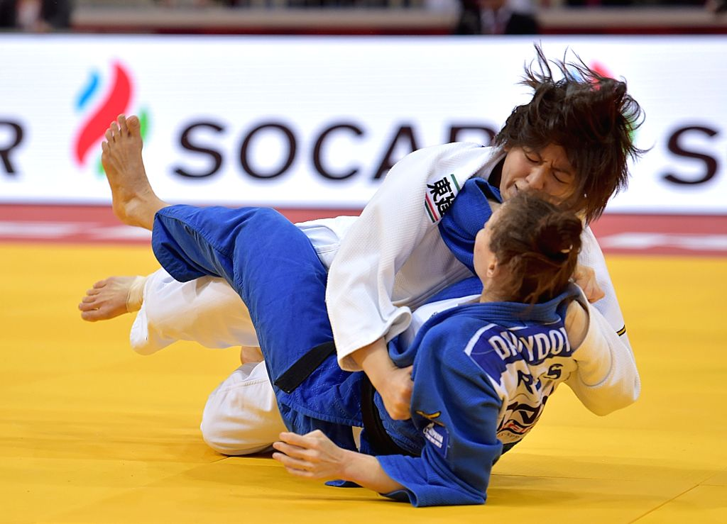 DUSSELDORF, Feb. 24, 2019 - Tashiro Miku (up) of Japan competes with Daria Davydova of Russia during women's -63kg final at the International Judo Federation (IJF) Dusseldorf Grand Slam 2019 in ...