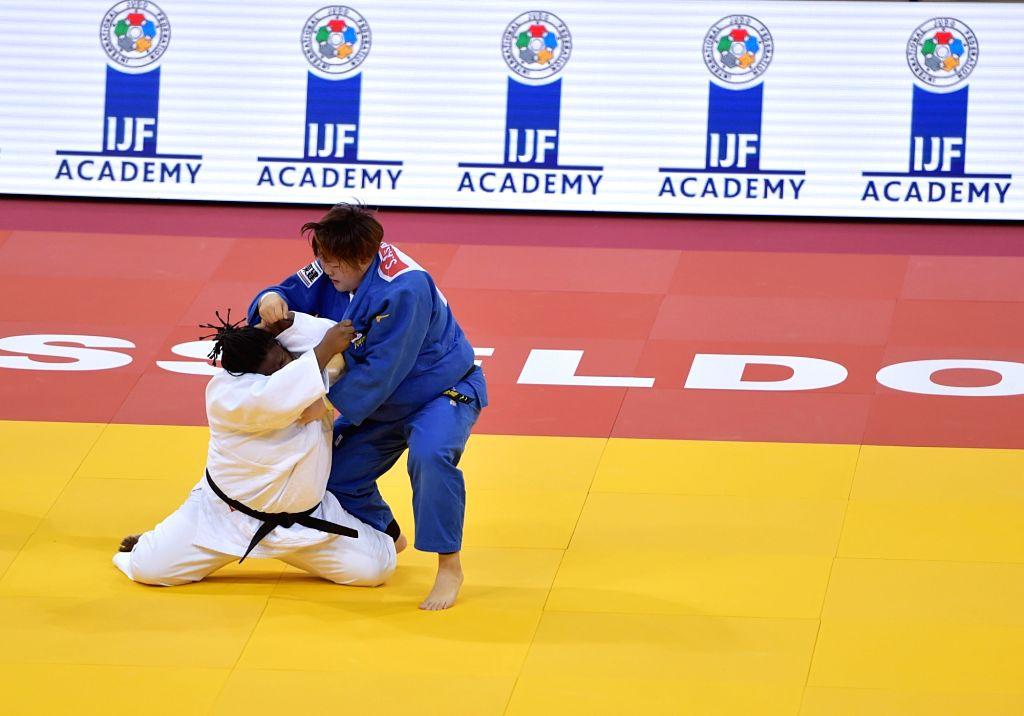 DUSSELDORF, Feb. 25, 2019 - Idalys Ortiz (L) of Cuba competes with Asahina Sarah of Japan during women's +78kg final at the International Judo Federation (IJF) Dusseldorf Grand Slam 2019 in ...