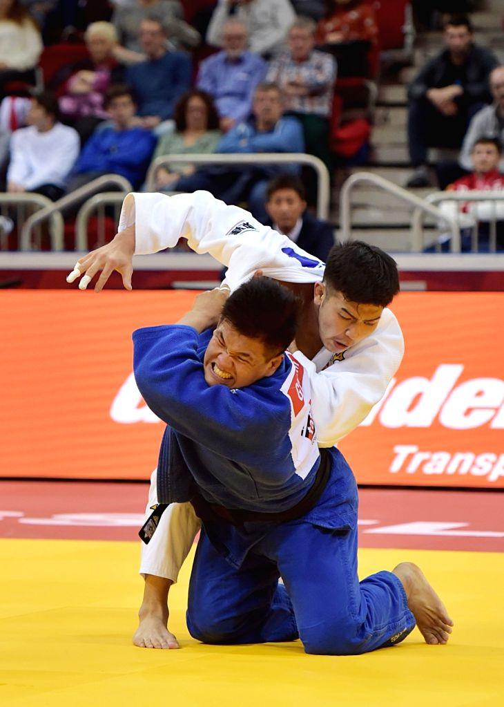 DUSSELDORF, Feb. 25, 2019 - Iida Kentaro (top) of Japan competes with Cho Guham of South Korea during men's -100kg final at the International Judo Federation (IJF) Dusseldorf Grand Slam 2019 in ...