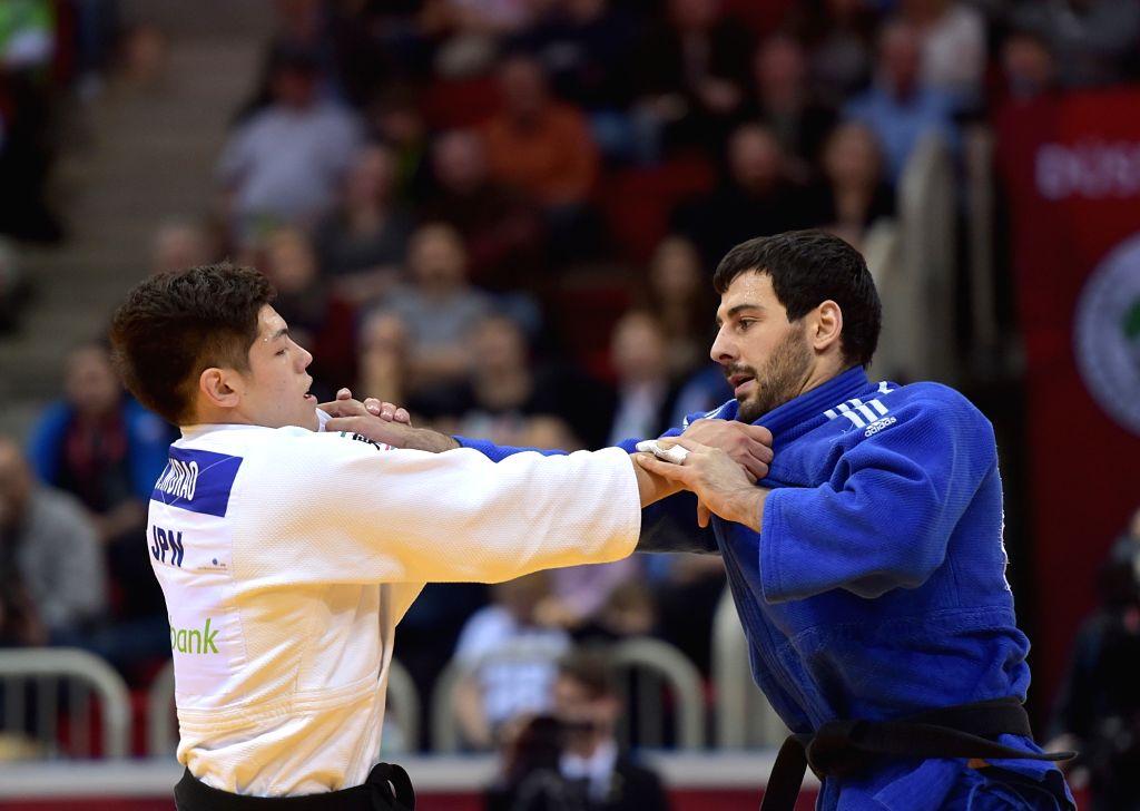 DUSSELDORF, Feb. 25, 2019 - Mammadali Mehdiyev (R) of Azerbaijan competes with Murao Sanshiro of Japan during men's -90kg final at the International Judo Federation (IJF) Dusseldorf Grand Slam 2019 ...