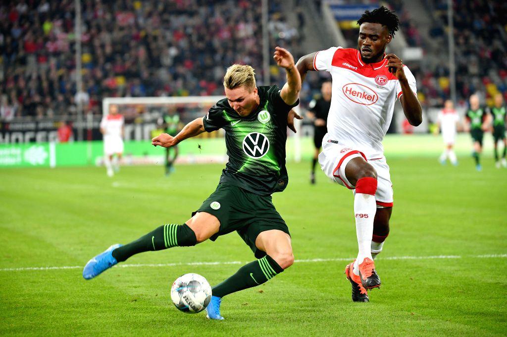 DUSSELDORF, Sept. 14, 2019 - Felix Klaus (L) of Wolfsburg vies with Kasim Adams Nuhu of Dusseldorf during the Bundesliga soccer match between Fortuna Dusseldorf and Vfl Wolfsburg in Dusseldorf, ...