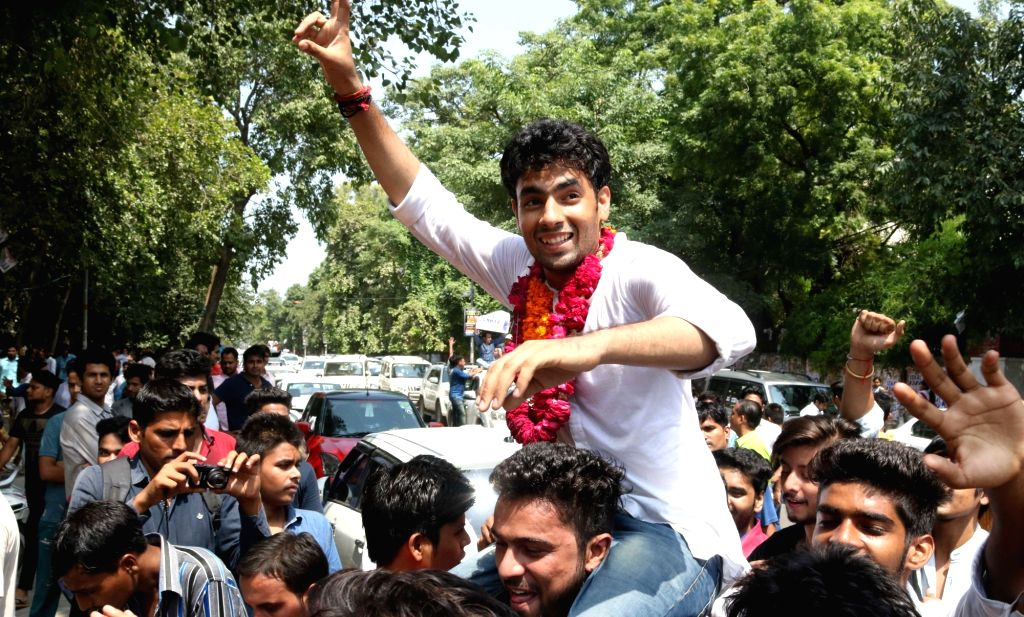DUSU President designate Amit Tanwar celebrates after ABVP won three out of four posts in DUSU in New Delhi, on Sept 10, 2016.