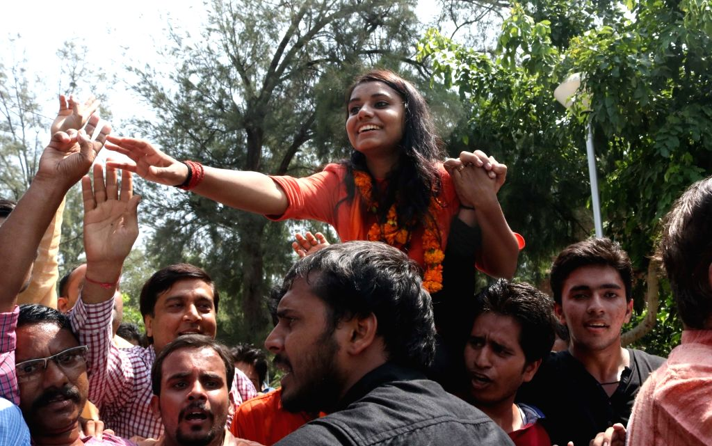 DUSU Vice President designate Priyanka celebrates after ABVP won three out of four posts in DUSU in New Delhi, on Sept 10, 2016.