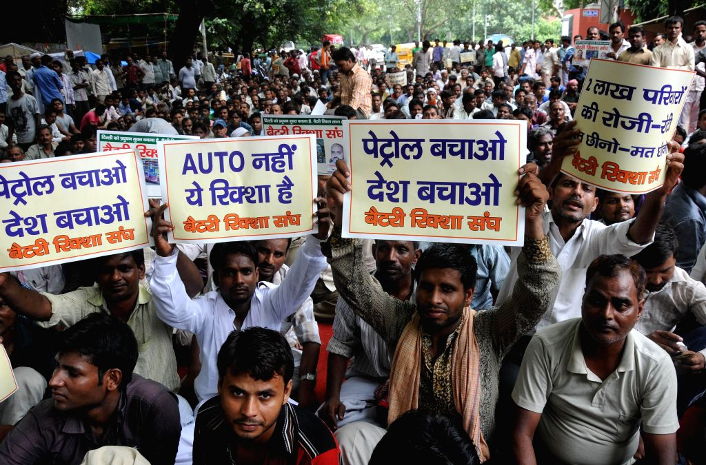 E-rickshaw drivers stage a demonstration in New Delhi on Aug 6, 2014, as High Court has imposed a ban on them till 14th August, 2014.