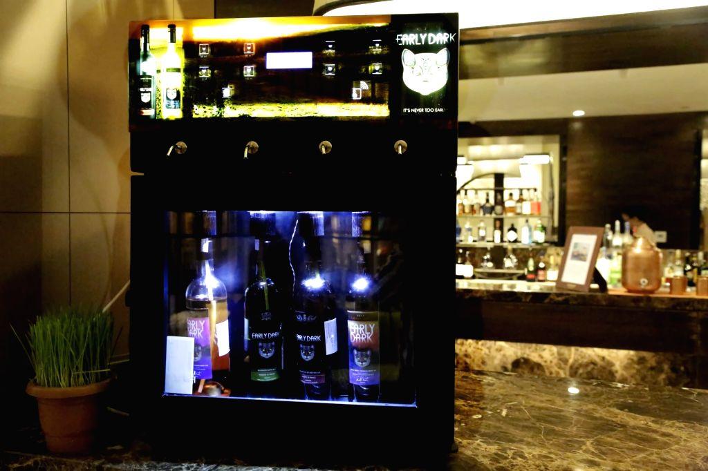 Early Dark Wine Dispenser.