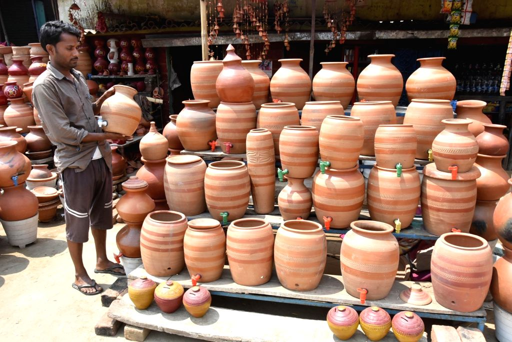 Earthen pots with taps being sold at a roadside stall on a hot sunny day, in Ranchi on April 4, 2018.