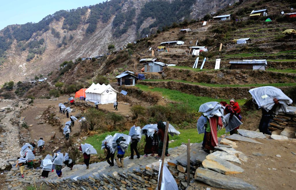 Earthquake victims return back after receiving blankets distributed by Nepal Army at Kerauja, one of worst quake-hit villages in Gorkha, Nepal, Jan. 13, 2016. Nepal ...
