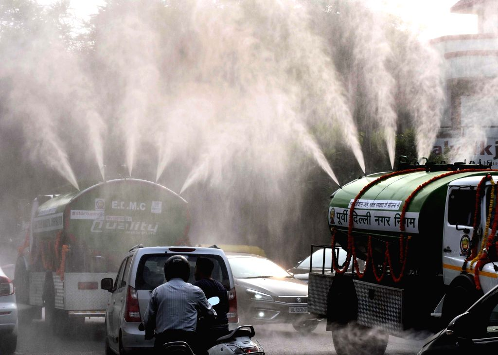East Delhi Municipal Corporation (EDMC) tankers sprinkles water on a street as a measure to curb pollution in New Delhi on Oct 16, 2019.