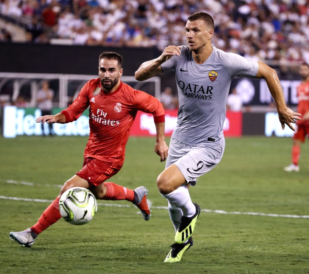 EAST RUTHERFORD, Aug. 8, 2018 - Roma's Edin Dzeko (R) competes during the International Champions Cup match between Real Madrid and AS Roma at MetLife Stadium in East Rutherford of New Jersey, the ...