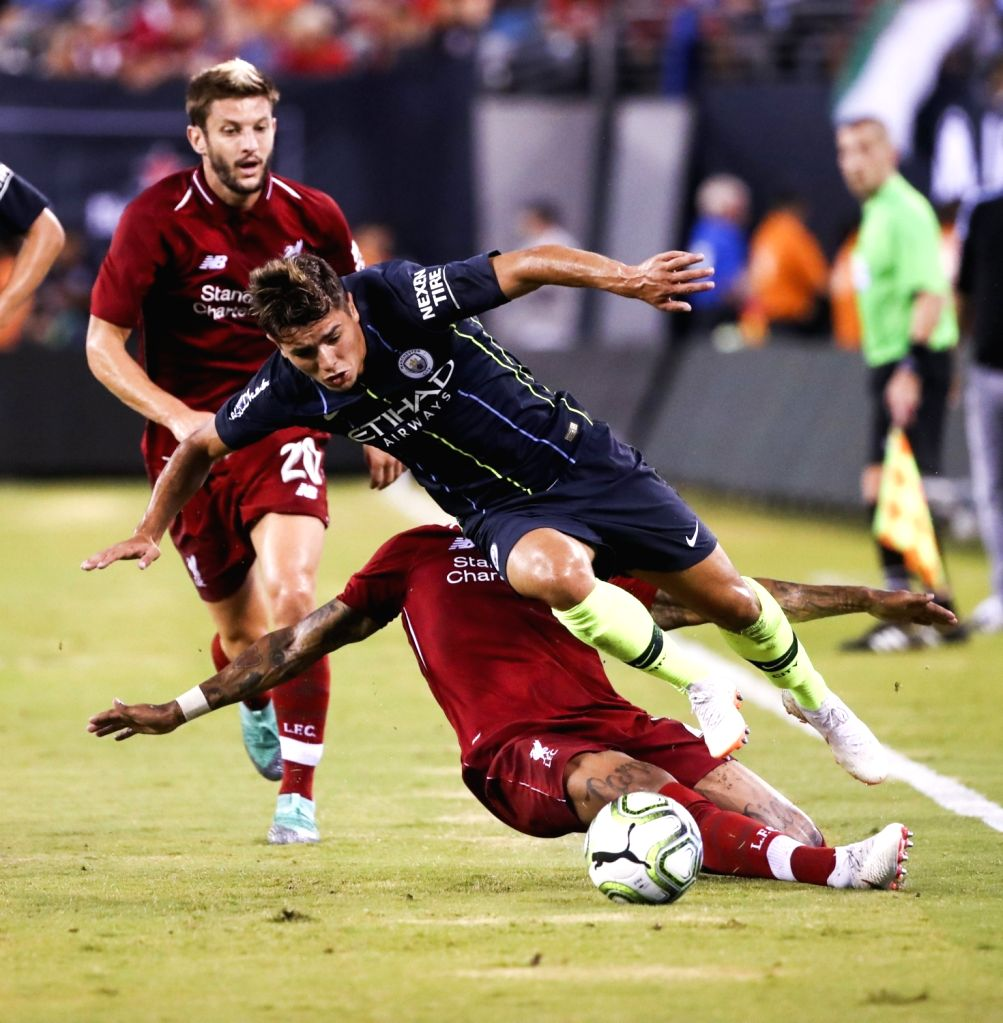 EAST RUTHERFORD, July 26, 2018 - Liverpool's Nathaniel Clyne (Lower) tackles the ball from Manchester City's Brahim Diaz (Upper) during the International Champions Cup  match between Manchester City ...