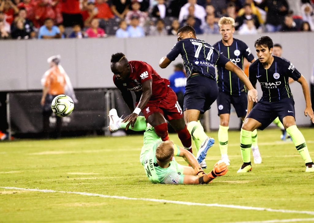 EAST RUTHERFORD, July 26, 2018 - Liverpool's Sadio Mane (L) passes through Manchester City's goal keeper Joe Hart during the International Champions Cup match at MetLife Stadium in East Rutherford of ...