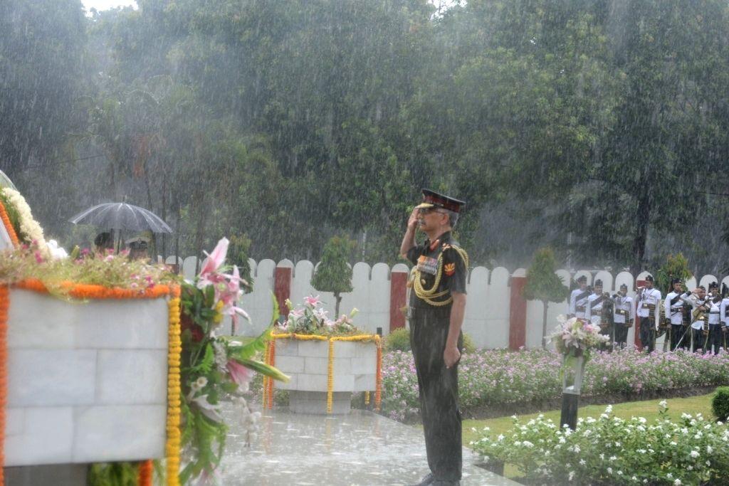 Eastern Army Commander Lt Gen Manoj Mukund Naravane pays tributes to the martyrs during rains, on the 20th Anniversary of Kargil Vijay Diwas, in Kolkata on July 26, 2019.