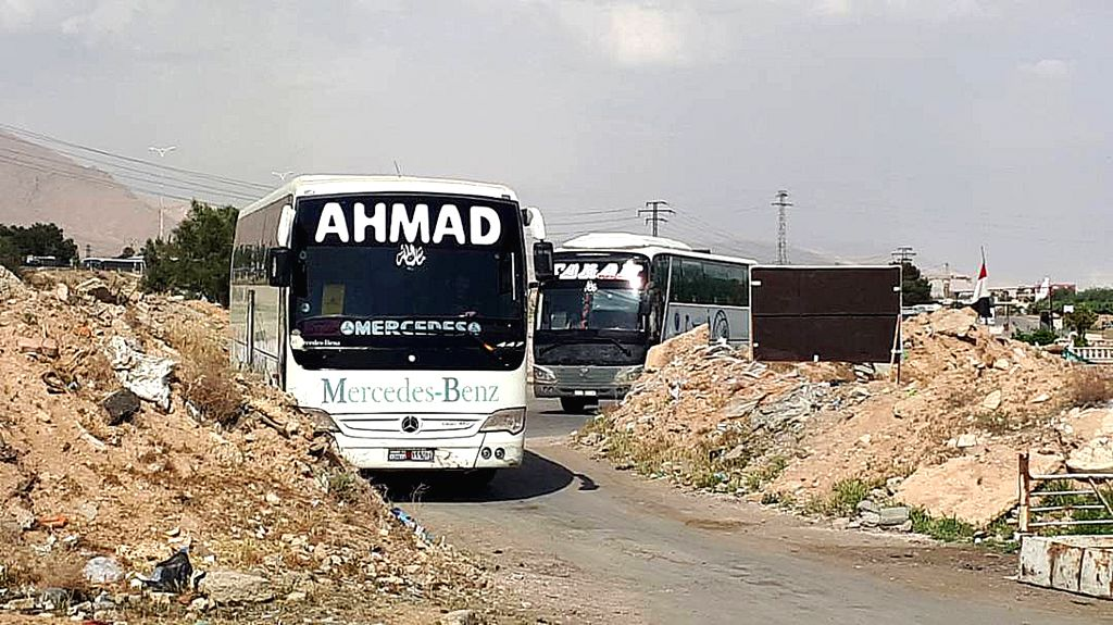 EASTERN GHOUTA, April 8, 2018 - Buses to evacuate militants of the Islam Army as well as the kidnapped people enter the Wafideen area near Douma, northeast of Damascus, Syria, on April 8, 2018. The ...