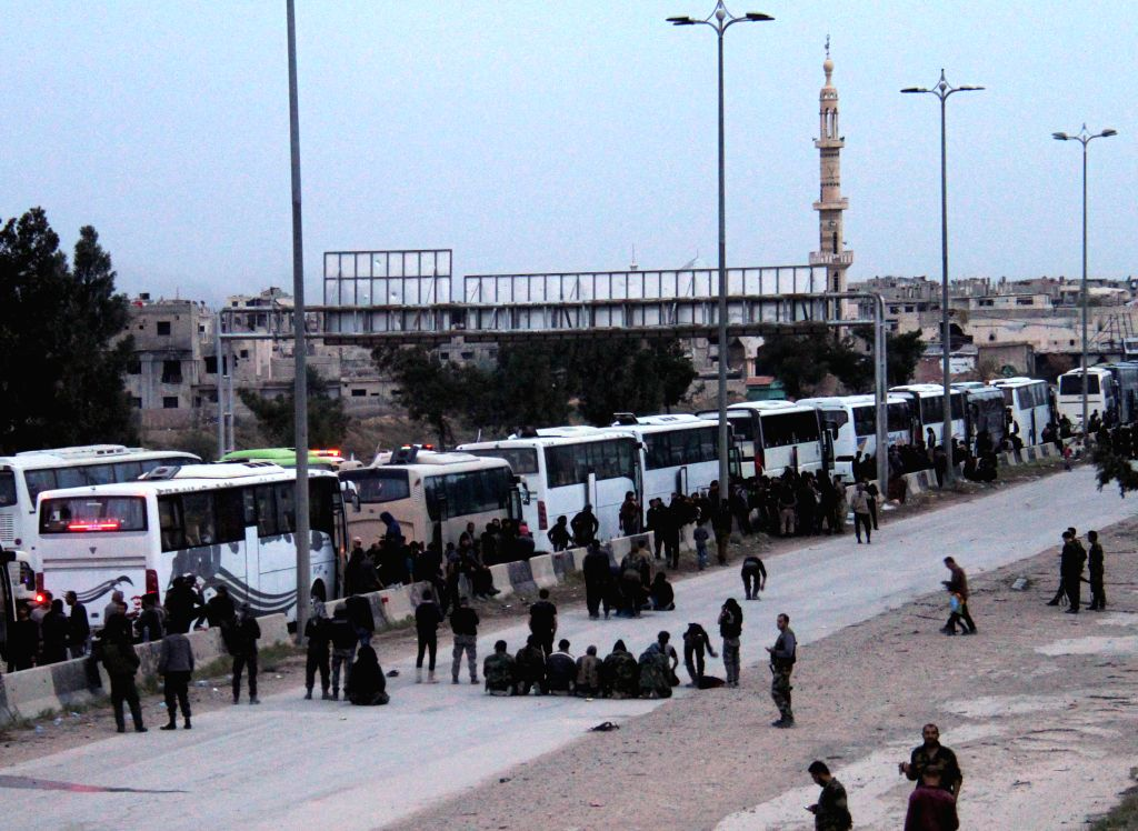 EASTERN GHOUTA, March 24, 2018 - Buses transport rebels and their families as they leave the capital Damascus' Eastern Ghouta countryside, Syria, on March 23, 2018. The Syrian army has seized control ...