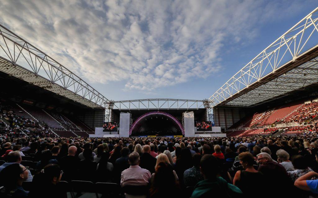 EDINBURGH, Aug. 2, 2019 - Spectators enjoy performance at the Edinburgh International Festival opening event in Edinburgh, Britain, on Aug. 2, 2019. The annual Edinburgh International Festival kicked ...