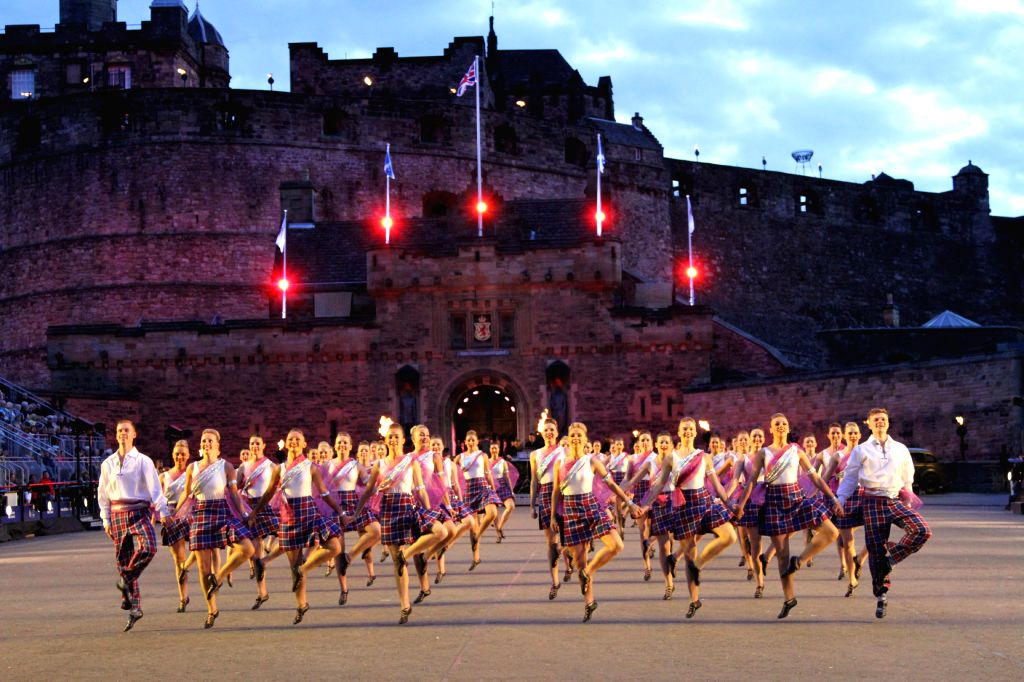 Dancers perform during the opening ceremony of the 66th Royal Edinburgh Military Tattoo in Edinburgh of Scotland, on the evening of Aug. 7, 2015. The theme of ...