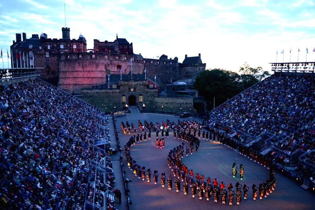 Members of a military band perform during the opening ceremony of the 66th Royal Edinburgh Military Tattoo in Edinburgh of Scotland, on the evening of Aug. 7, 2015. ...