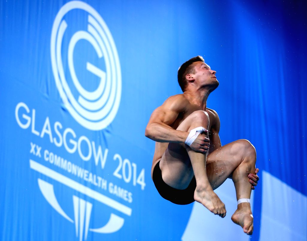 Cody Yano of Canada competes during the men's 1m springboard final of diving at the 2014 Glasgow Commonwealth Games in Royal Commonwealth Pool in Edinburgh, ...