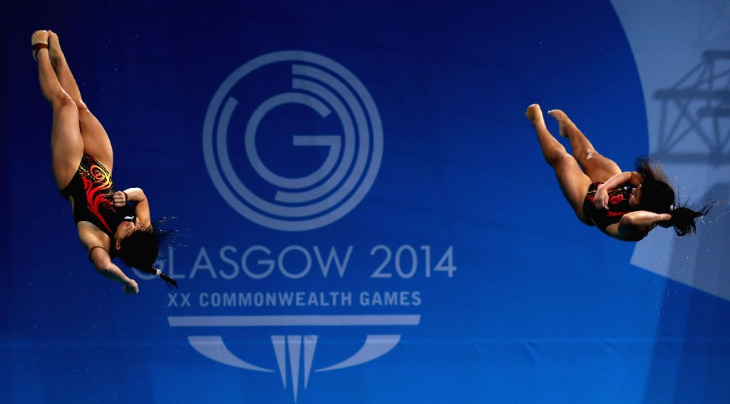 Nur Dhabitah Sabri/Ng Yan Yee of Malaysia compete during the women's synchronized 3m springboard final of diving at the 2014 Glasgow Commonwealth Games in Royal ..