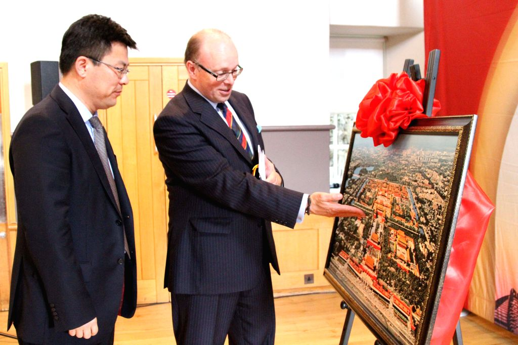 EDINBURGH, June 28, 2016 - Zhang Huazhong (L), Chinese Deputy Consul General in Edinburgh, and Edinburgh Tattoo chief executive and producer Brigadier David Allfrey talk about a picture at the ...