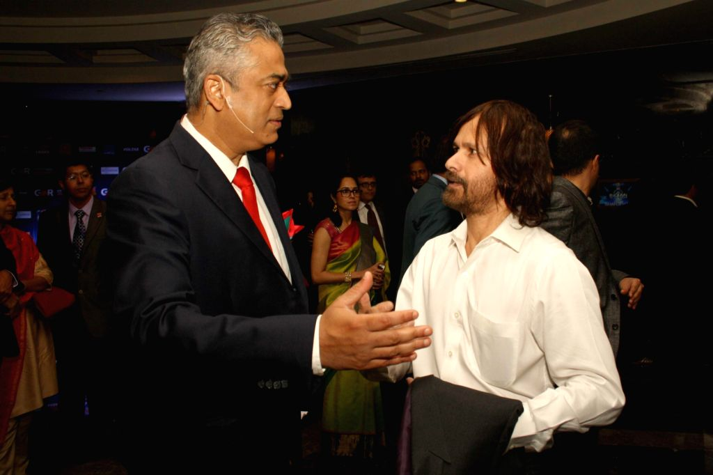 Editor-in-Chief of IBN, Rajdeep Sardesai and Ajit Tendulkar, Sachin Tendukar's brother during The CNN-IBN Indian of the Year awards function, in New delhi on December 20, 2013. (Amlan ...