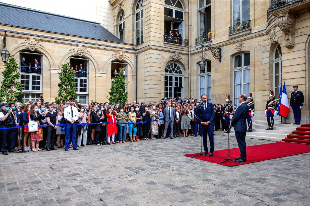 Edouard Philippe (2nd R, Front) and Jean Castex (1st R, Front) attend the handover ceremony in the courtyard of the Hotel Matignon in Paris, France, on July 3, 2020. ...