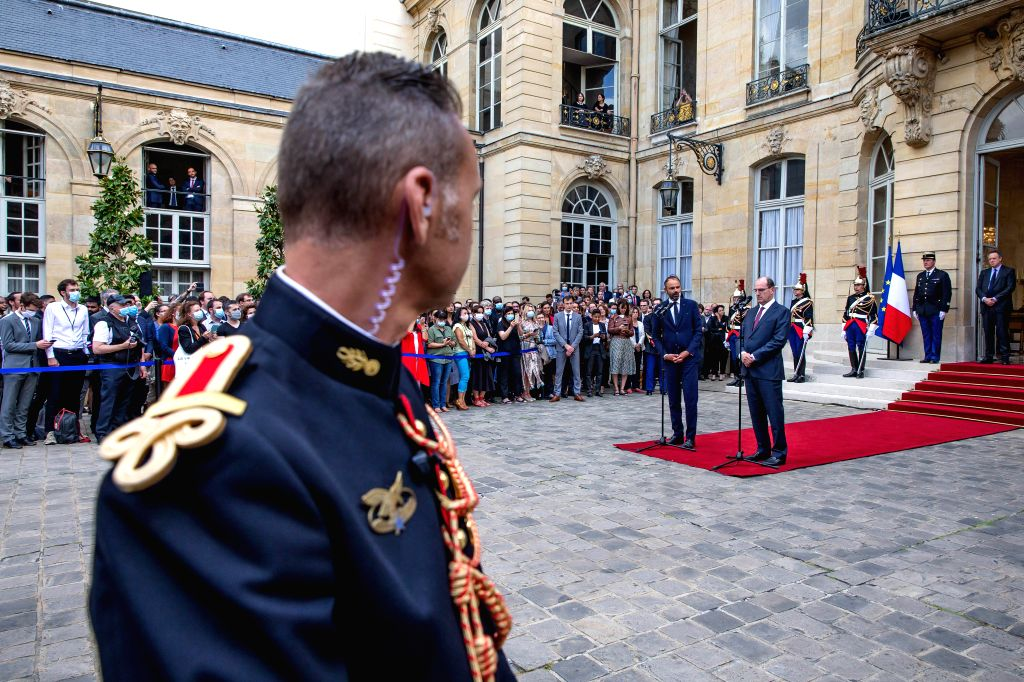 Edouard Philippe and Jean Castex attend the handover ceremony in the courtyard of the Hotel Matignon in Paris, France, on July 3, 2020. Jean Castex, a 55-year-old top ...