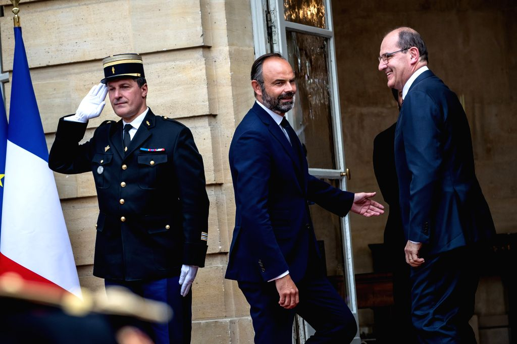Edouard Philippe (C) and Jean Castex (R) attend the handover ceremony in the courtyard of the Hotel Matignon in Paris, France, on July 3, 2020. Jean Castex, a ...