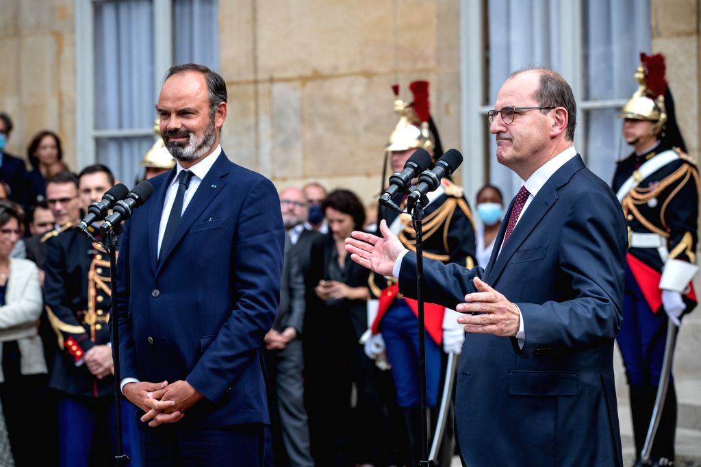 Edouard Philippe (L) and Jean Castex attend the handover ceremony in the courtyard of the Hotel Matignon in Paris, France, on July 3, 2020. Jean Castex, a 55-year-old ...
