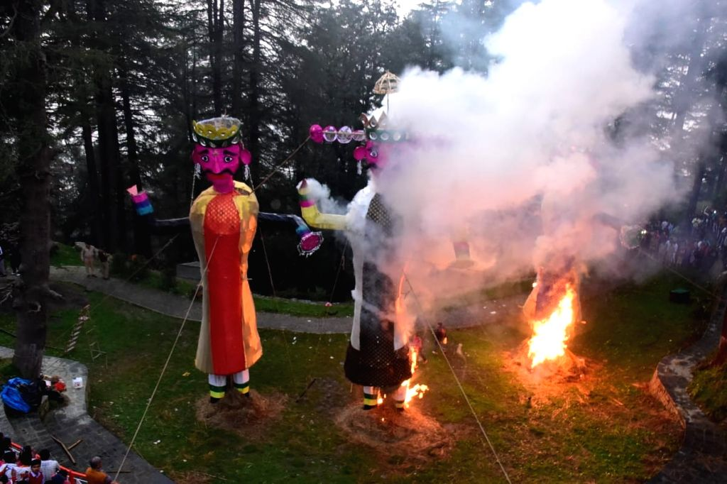 Effigies of demon king Ravana, his son Meghnad, and brother Kumbhakarna being burned during Dussehra celebrations, at Jakhu Temple in Shimla on Oct 8, 2019.