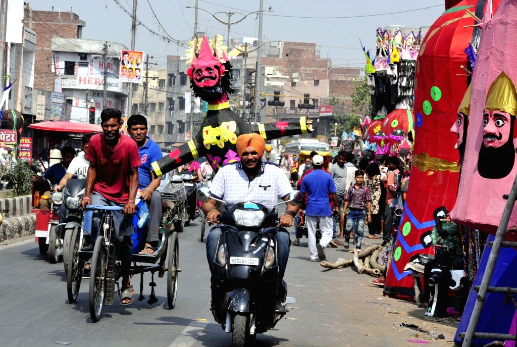 Effigies of demons being taken to Dussehra grounds ahead of Dussehra in Amritsar, on Sept 29, 2017.
