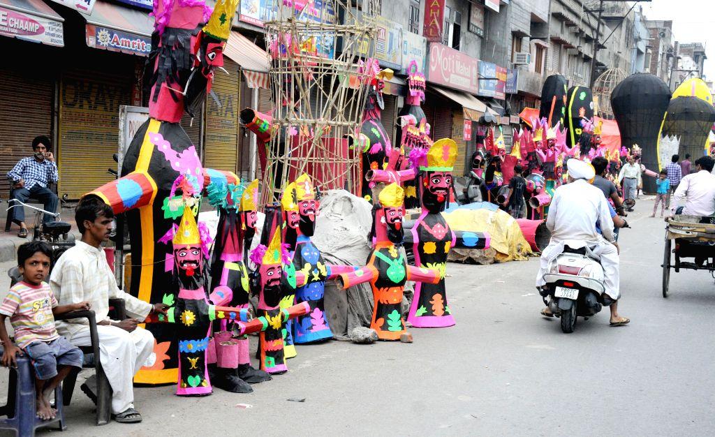 """Effigies of """"Raavan"""" being sold on the roadside in Amritsar on Oct 19, 2015."""