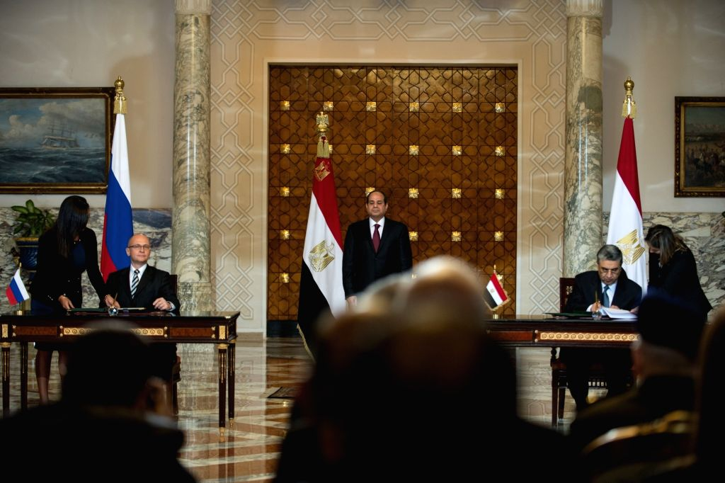 Egyptian President Abdel Fattah al-Sisi (C) witnesses the signing ceremony held in the presidential palace in Cairo, Egypt, on Nov. 19, 2015. Egypt and Russia signed ...