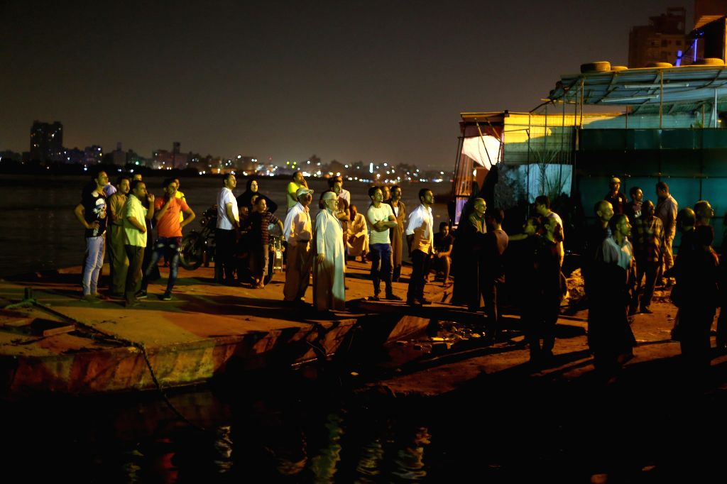 Egyptians gather along the Nile River in the Warraq district of Giza, southwest of Cairo, Egypt, on July 23, 2015. At least 19 people died on Wednesday late night in ...