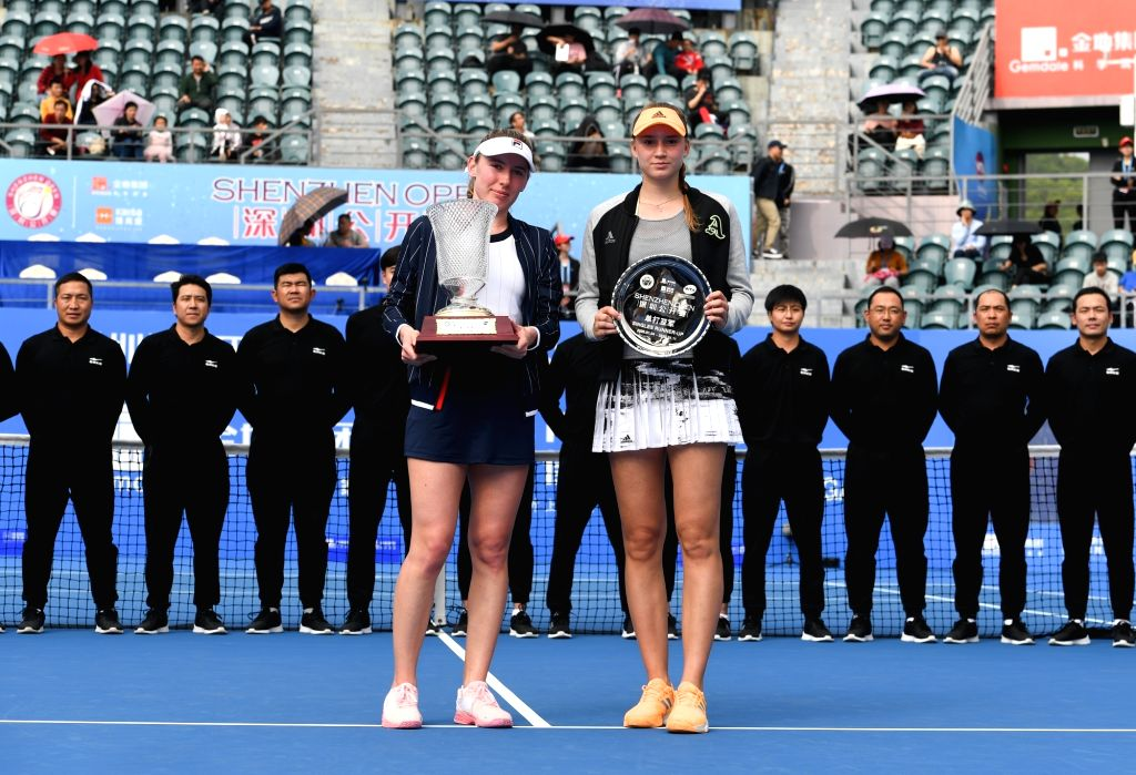 Ekaterina Alexandrova (L) of Russia and Elena Rybakina of Kazakhstan pose with their trophies during the awarding ceremony after the women's singles final match at ...