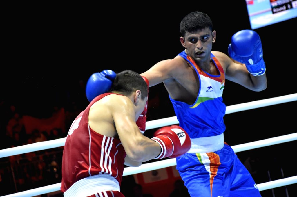 Ekaterinburg: India's Manish Kaushik and Kyrgyzstan's Argen Ullu Kadyrbek in action during the AIBA Men's World Championships Round 1 debut match in Ekaterinburg, Russia on Sep 12, 2019. (Photo: IANS)