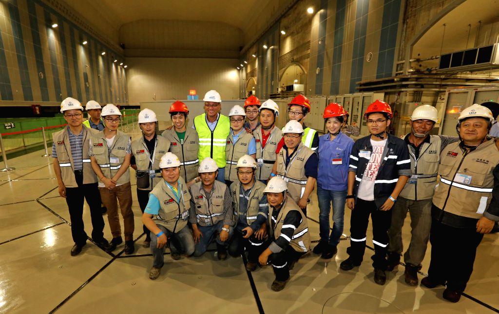 EL CHACO, April 14, 2016 - Ecuador's Vice President Jorge Glas (6th L, rear) poses with workers in the Coca Codo Sinclair hydroelectric power station facilities, in El Chaco, Napo province, Ecuador, ...