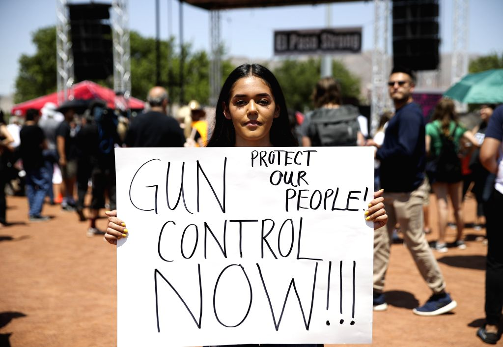 EL PASO, Aug. 8, 2019 (Xinhua) -- College student Jennifer Estrada takes part in a rally for gun control and anti-racism, in El Paso, Texas, the United States, Aug. 7, 2019. U.S. President Donald Trump and First Lady Melania Trump on Wednesday aftern
