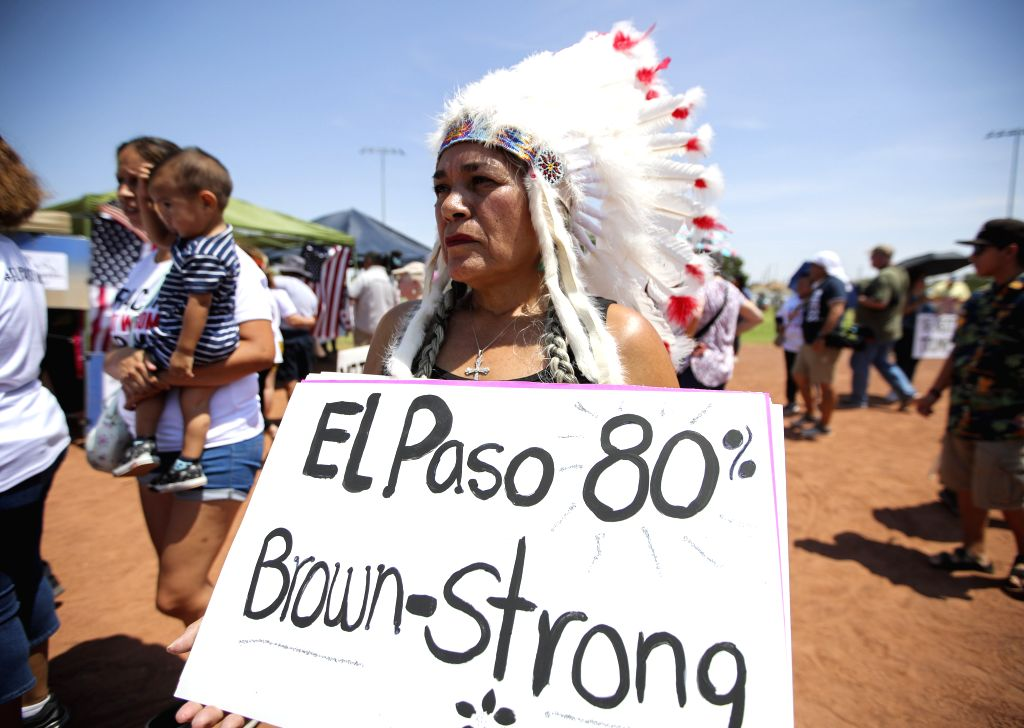 EL PASO, Aug. 8, 2019 (Xinhua) -- Indian American Priscilla Perez takes part in a rally for gun control and anti-racism, in El Paso, Texas, the United States, Aug. 7, 2019. U.S. President Donald Trump and First Lady Melania Trump on Wednesday afterno